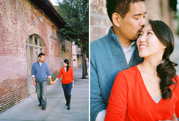 engagement photos next to a brick building